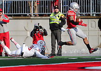Indiana Hoosiers safety Tony Fields (19) fails to tackle Ohio State Buckeyes running back Jalin Marshall (17) as he heads into the end zone for a touchdown in the fourth quarter of the college football game between the Ohio State Buckeyes and the Indiana Hoosiers at Ohio Stadium in Columbus, Saturday afternoon, November 22, 2014. The Ohio State Buckeyes defeated the Indiana Hoosiers 42 - 27. (The Columbus Dispatch / Eamon Queeney)