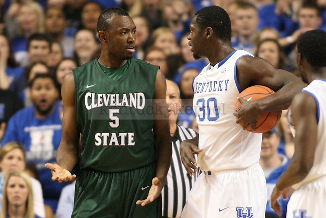 Cleveland State center Ismaila Dauda and UK forward Julius Randle argue during the first half of the University of Kentucky men's basketball game vs. Cleveland State at Rupp Arena in Lexington, Ky., on Monday, November 25, 2013. UK won 68-61. Photo by Tessa Lighty | Staff
