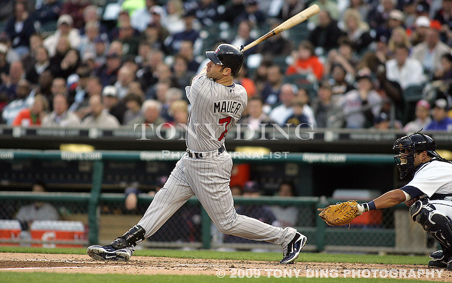 4 May 2009: Minnesota Twins catcher Joe Mauer (7) watch his hit at bat during the Twins at Tigers Major League Baseball game at Comerica Park, in Detroit, Michigan. Minnesota won 7-2.