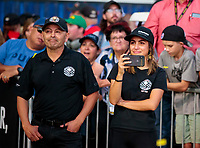 Nov 17, 2019; Pomona, CA, USA; Mike Salinas (left) and Jasmine Salinas look on as NHRA pro stock motorcycle rider Jianna Salinas (not pictured) talks after winning the Auto Club Finals at Auto Club Raceway at Pomona. Mandatory Credit: Mark J. Rebilas-USA TODAY Sports