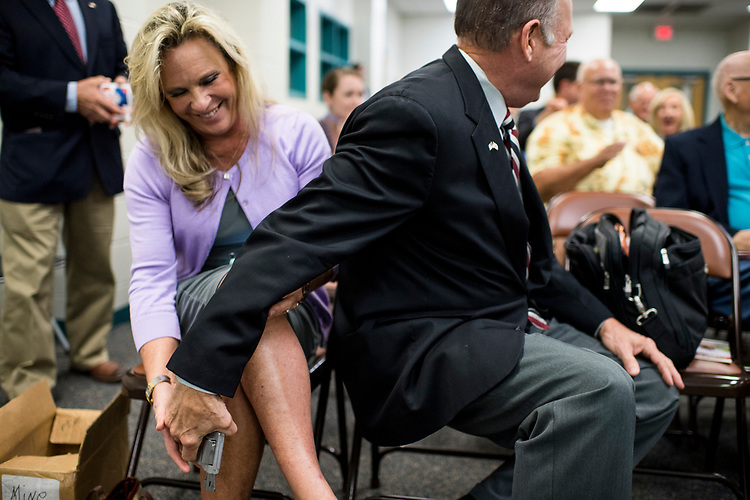 UNITED STATES - AUGUST 3: GOP candidate for U.S. Senate Roy Moore returns his wife's hand gun to her after displaying it as a way to show support for the 2nd amendment after candidates were asked about their views on gun rights during a candidates' forum in Valley, Ala., on Thursday, Aug. 3, 2017. The former Chief Justice of the Alabama Supreme Court is running tin the special election to fill the seat vacated by Attorney General Jeff Sessions. (Photo By Bill Clark/CQ Roll Call)