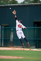 GCL Braves first baseman Ray Hernandez (46) jumps to try to receive an errant throw during the second game of a doubleheader against the GCL Yankees West on July 30, 2018 at Champion Stadium in Kissimmee, Florida.  GCL Braves defeated GCL Yankees West 5-4.  (Mike Janes/Four Seam Images)