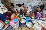 A Rohingya family, having just crossed the border from Myanmar, waits to complete registration in the Kutupalong Refugee Camp near Cox's Bazar, Bangladesh. More than 600,000 Rohingya refugees have fled government-sanctioned violence in Myanmar for safety in this and other camps in Bangladesh.