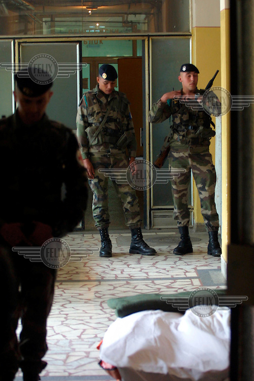 French KFOR troops prepare to move three injured American police officers from the hospital in Northern Mitrovice to their base nearby. Two Americans and one Jordanian, all UN police officers, were killed in an extraordinary gunfight between the two groups.