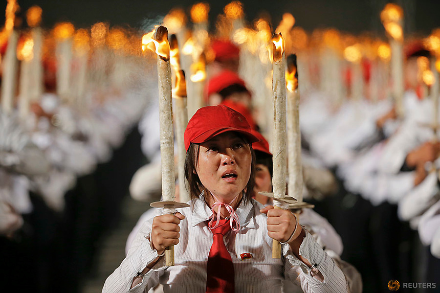 A participant cries taking part in a torchlight procession in the capital's main ceremonial square, a day after the ruling Workers' Party of Korea party wrapped up its first congress in 36 years, in Pyongyang, North Korea May 10, 2016.  REUTERS/Damir Sagolj