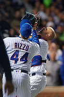 Chicago Cubs catcher David Ross (3) catches a foul ball popup as Anthony Rizzo (44) also attempts to catch the ball Game 5 of the Major League Baseball World Series against the Cleveland Indians on October 30, 2016 at Wrigley Field in Chicago, Illinois.  (Mike Janes/Four Seam Images)
