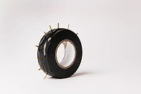 Electrical tape and pins by Adam Wiseman. Sculptures of corporate objects for Obstacle. London