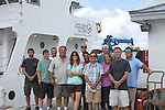 CFCC Marine Technology faculty stand in front of the R/V Cape Hatteras on the Cape Fear River