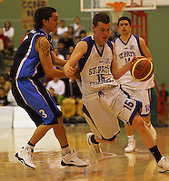 Jacob Ashley goes round Ezra Nikora during the NZ Secondary Schools Basketball Championships match between Fraser High School and St Patricks College at Arena Manawatu, Palmerston North, New Zealand on Saturday 4 October 2008. Photo: Dave Lintott / lintottphoto.co.nz