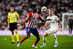 Thomas Teye of Atletico de Madrid (L) controls the ball during their La Liga  2018-19 match between Real Madrid CF and Atletico de Madrid at Santiago Bernabeu on September 29 2018 in Madrid, Spain. Photo by Diego Souto / Power Sport Images