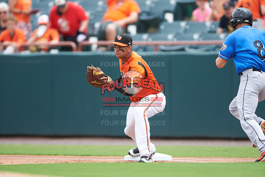 Bowie Baysox first baseman Garabez Rosa (2) waits for a throw as Todd Hankins (8) runs through the bag during the first game of a doubleheader against the Akron RubberDucks on June 5, 2016 at Prince George's Stadium in Bowie, Maryland.  Bowie defeated Akron 6-0.  (Mike Janes/Four Seam Images)
