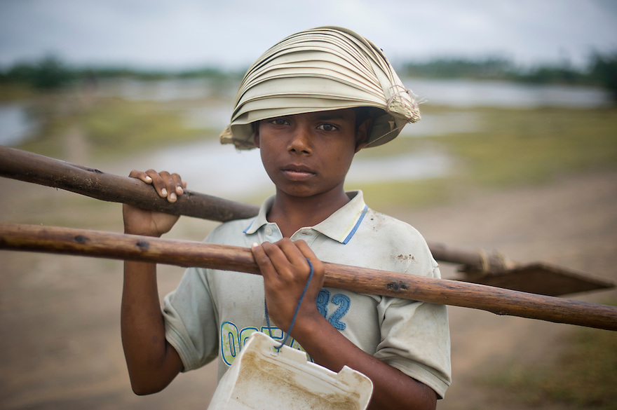 An Indian boy from a tribal community poses for a photograph in the Southern Indian state of Tamil Nadu on the 30th of October 2010.