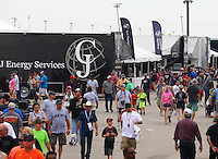 Apr 26, 2015; Baytown, TX, USA; NHRA fans walk in the pit area in Nitro Alley during the Spring Nationals at Royal Purple Raceway. Mandatory Credit: Mark J. Rebilas-