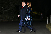 United States President Donald J. Trump and first lady Melania Trump hold hands as they walk on the South Lawn as they arrive to the White House on January 14, 2020 in Washington, DC. President Trump and first lady attended the College Football Playoff National Championship in New Orleans, Louisiana.<br /> Credit: Oliver Contreras / Pool via CNP