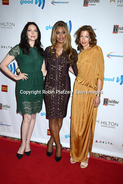 Laura Prepon, Laverne Cox and Alysia Reiner attend the 25th Annual GLAAD Media Awards at the Waldorf Astoria Hotel in New York City, NY on May 3, 2014.