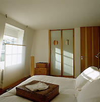 The transluscent roller blinds provide privacy in this bedroom, yet allow the light to filter in