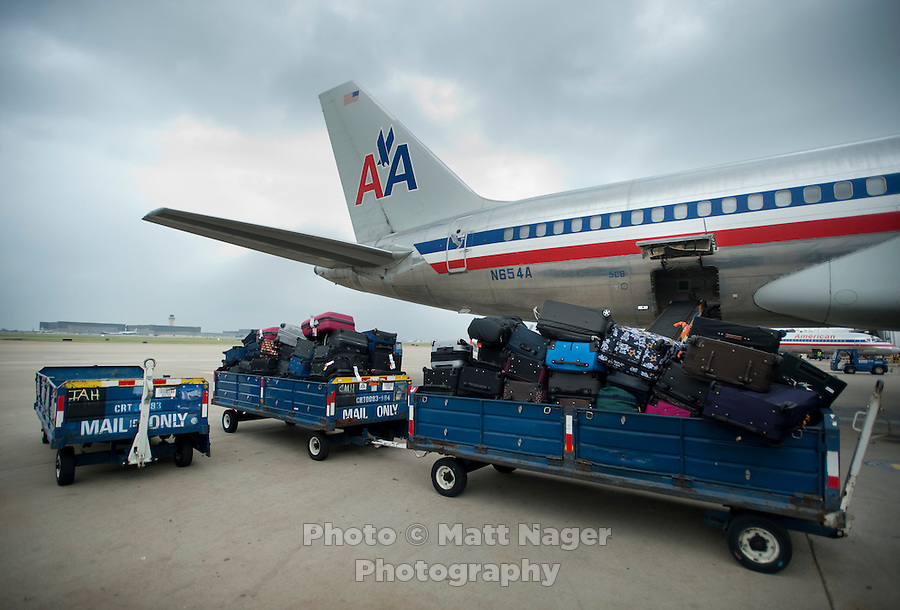 Baggage waits to be loaded on an American Airlines plane before for takeoff at Dallas-Fort Worth International Airport (DFW) in Dallas, Texas, Friday, May 14, 2010. ..PHOTO: MATT NAGER