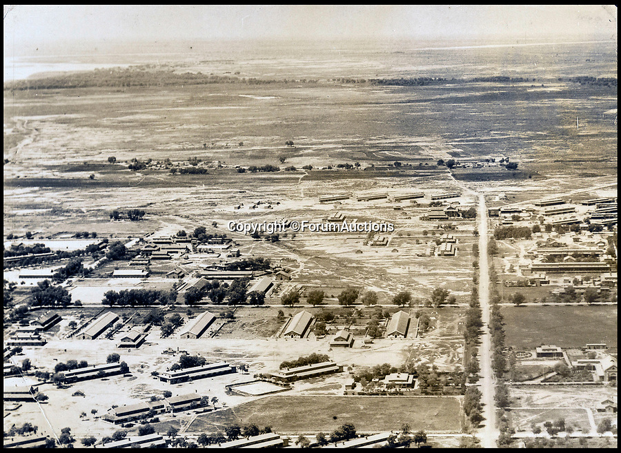 BNPS.co.uk (01202 558833)<br /> Pic: ForumAuctions/BNPS<br /> <br /> An army settlement at Risalpur.<br /> <br /> Stunning aerial photos taken by an RAF pilot who was based in northern India in the 1930s have come to light.<br /> <br /> The album of 52 photos of the North West Frontier, which today is part of modern day Pakistan, includes breathtaking snaps of the Khyber Pass and the Himalayas at 21,000ft.<br /> <br /> The pilot, who is pictured in the album and called himself 'Nuncs', also took an interest in the native population.<br /> <br /> There are snaps of a snake charmer entertaining the masses, while a father and son can be seen paddling in a traditional round basket boat on a river.