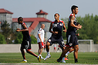 New York Red Bulls Thierry Henry (14) warms up with other memebers of the team at the start of a New York Red Bulls practice on the campus of Montclair State University in Upper Montclair, NJ, on July 16, 2010.