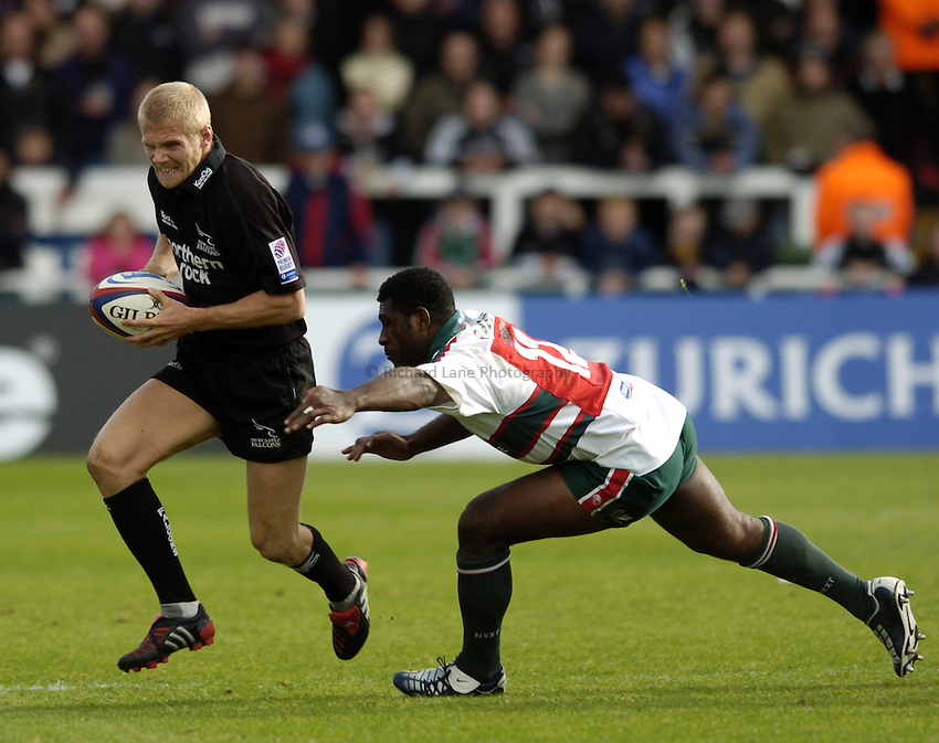 Photo. Jed Wee..Newcastle Falcons v Leicester Tigers, Zurich Premiership, 02/10/2004..Newcastle's Michael Stephenson (L) with Leicester's Seru Rabeni.