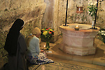 Israel, Jerusalem, Visitation Day at the Church of the Visitation in Ein Karem, a prayer by the ancient well
