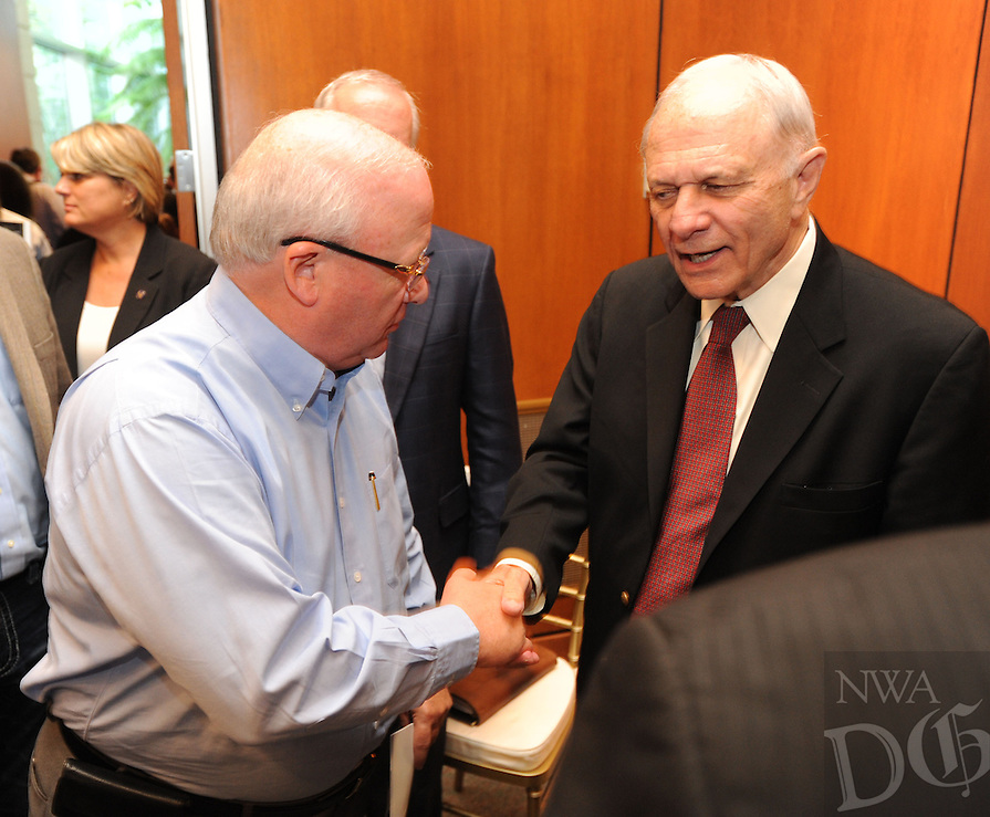 NWA Democrat-Gazette/ANDY SHUPE<br /> Gary George, chairman of George's Inc., (left) speaks with former Sen. David Pryor Tuesday, Oct. 6, 2015, during a celebration for the Center for Excellence for Poultry Science's 20th anniversary and to announce a $1.3 million gift from Tyson Foods Inc. on the University of Arkansas campus in Fayetteville.
