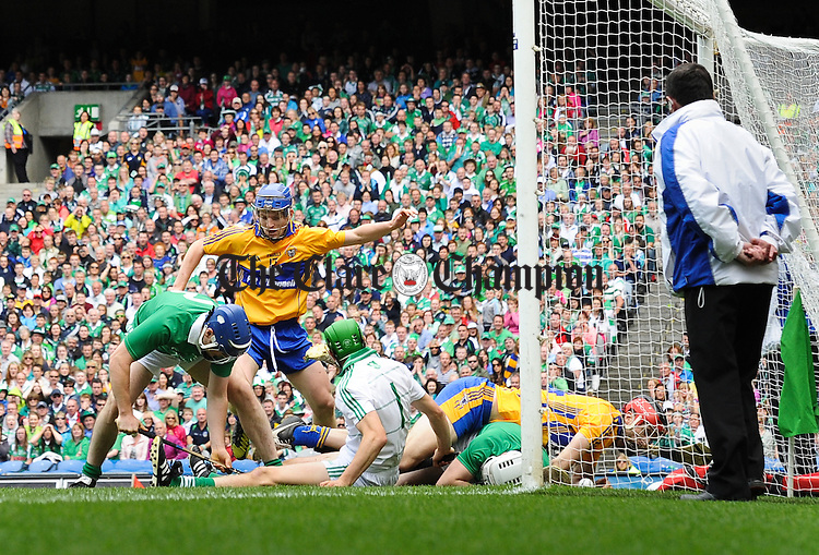 Darach Honan of Clare, with support from Podge Collins scores a goal against Richie Mc Carthy and Nickie Quaid and Tom Condon  of Limerick scores during the All-Ireland senior championship semi final at Croke Park. Photograph by John Kelly.