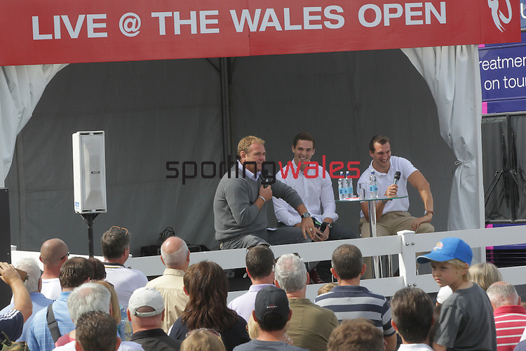 Scott Quinnell conducting a Q&A with Wales and Lions heroes George North and Sam Warburton in the tented village at the ISPS Handa Wales Open 2013<br /> Celtic Manor Resort<br /> <br /> 01.09.13<br /> <br /> ©Steve Pope-Sportingwales