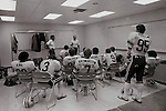 FTB 403 D-39<br /> <br /> Meeting prior to BYU vs University of Colorado. Coach Norm Chow, Coach Ted Tollner, 3 Scott Collie, 8 Steve Young, 7 Eric Krzmarzick, 4 Lennon Ledbetter, 9 Jim McMahon, 95 Gordon Hudson.<br /> <br /> September 26, 1981<br /> <br /> Photo by Mark Philbrick/BYU<br /> <br /> &copy; BYU PHOTO 2009<br /> All Rights Reserved<br /> photo@byu.edu  (801)422-7322