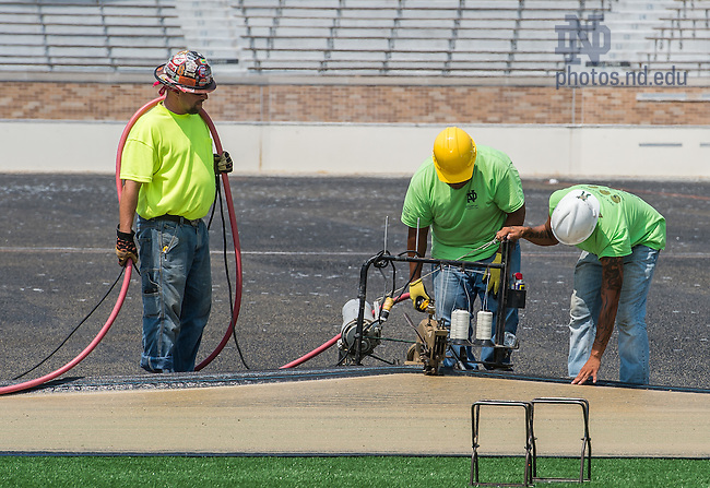 Jul. 22, 2014; Installation of field turf in Notre Dame Stadium.<br /> <br /> Photo by Matt Cashore/University of Notre Dame