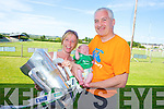Parents Sharon and Timmy O'Sullivan and 5week old Odhran with the Muster Senior Hurling cup which visited Abbeyfeale last Saturday.
