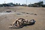 REIGER PARK, SOUTH AFRICA - MAY 23: The blanket and shoes remain after an unidentified man from Mozambique was burned to death on May 23, 2008 at the Ramaphosa squatter camp outside Johannesburg, South Africa. Locals chased out African immigrants in the area. Many shacks were burned down during xenophobic attacks in the township. A man was burned alive down the street and thousands of people fled to a nearby police station for safety. (Photo by: Per-Anders Pettersson/Getty Images).