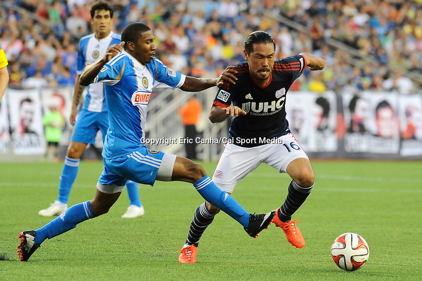 June 28, 2014 - Foxborough, Massachusetts, U.S. - Philadelphia Union defender Raymon Gaddis (28) and New England Revolution midfielder Daigo Kobayashi (16) battle for the ball during the MLS game between the Philadelphia Union and the New England Revolution held at Gillette Stadium in Foxborough Massachusetts.  Philadelphia defeated New England 3-1.  Eric Canha/CSM