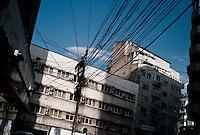 ROMANIA / Bucharest / August 2009 / Communist era buildings and communication cables.  © Davin Ellicson / Anzenberger