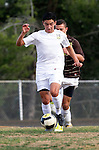 Palos Verdes, CA 01/22/13 - Oscar Chacon (Peninsula #8) in action during the West vs Peninsula boys varsity soccer game at Peninsula High School.