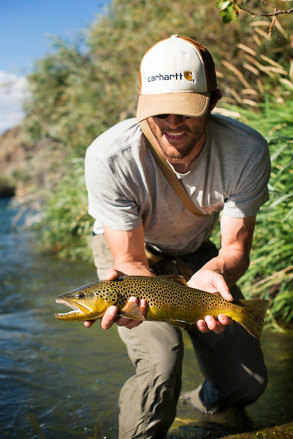 Nick Romano of Bozeman holds a brown trout caught from the Beaverhead River.