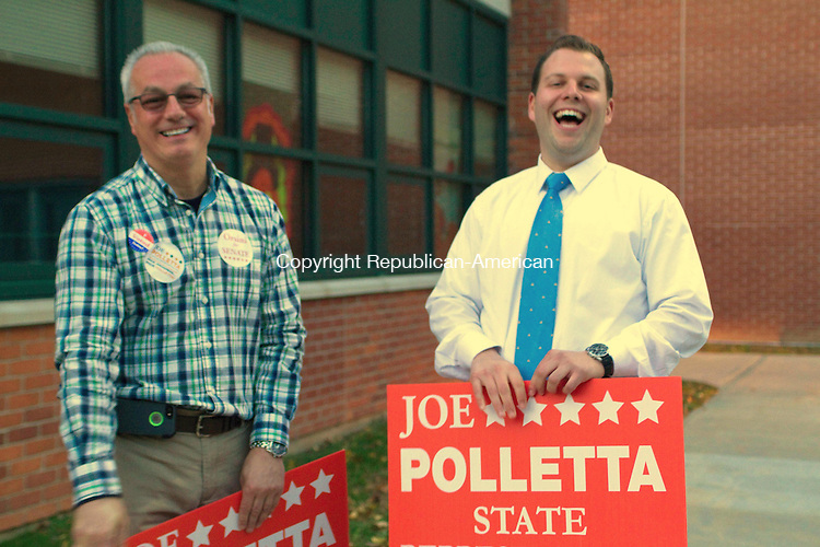WATERTOWN, CT, 04 November 2014-110414LW07 - Ken Demirs, left, and candidate for the 68th State Senate seat Joseph Polletta, right, have a laugh while campaigning at Swift Middle School in Watertown Tuesday. Laraine Weschler Republican-American