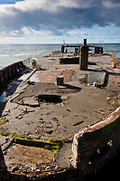 "The California State Parks website sheds light on what is at the end of the fishing pier at Seacliff State Beach:  ""The USS Palo Alto, one of only three cement ships built during World War I, has been a popular attraction for visitors since it was put in place in 1929.""  More can be found at:   http://www.santacruzstateparks.org/parks/seacliff/    and   http://www.parks.ca.gov/default.asp?page_id=543"