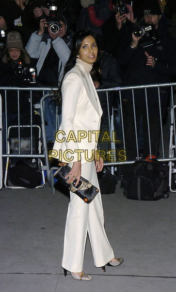 PADMA LAKSHMI.The 2006 National Board Of Review Awards Gala at Cipriani on 42nd Street, New York, New York, USA. - Arrivals.January 9th, 2007.full length white trousers jacket suit beige poloneck clutch purse black.CAP/ADM/BL.©Bill Lyons/AdMedia/Capital Pictures *** Local Caption ***
