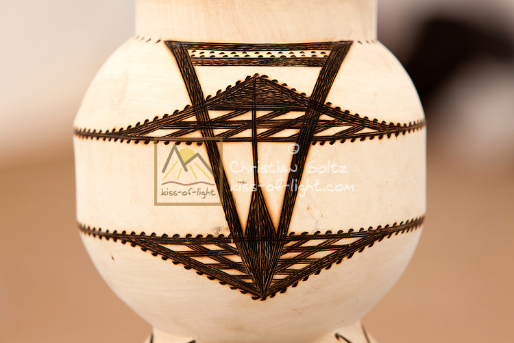 Omaholo<br /> Traditional goblets used to serve traditional<br /> beer (Omalodu) and Marula drink (Omaongo).<br /> They can be made from different trees such as:<br /> Ombo, Omughete and Omupopo. They are<br /> then decorated with different artist drawings.