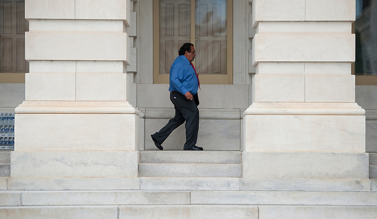 UNITED STATES - AUGUST 1: Progressive Caucus chair Rep. Raul Grijalva, D-Ariz., smokes a cigarette as he walks to Capitol to cast his vote on the debt ceiling bill in the House of Representatives on Monday, Aug. 1, 2011. (Photo By Bill Clark/Roll Call)
