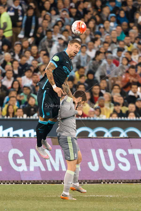 Melbourne, 24 July 2015 - Aleksandar Kolarov of Manchester City heads the ball in game three of the International Champions Cup match between Manchester City and Real Madrid at the Melbourne Cricket Ground, Australia. Real Madrid def City 4-1. (Photo Sydney Low / AsteriskImages.com)