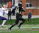 07 October 2006: Wake Forest's Kevin Marion (14) returns the opening kick 93 yards to the Clemson 7. The Clemson University Tigers defeated the Wake Forest University Demon Deacons 27-17 at Groves Stadium in Winston-Salem, North Carolina in an Atlantic Coast Conference NCAA Division I College Football game.