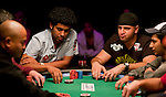 Michael Mizrachi is eliminated in 8th. place.