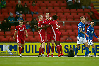 24th November 2019; McDairmid Park, Perth, Perth and Kinross, Scotland; Scottish Premiership Football, St Johnstone versus Aberdeen; Sam Cosgrove of Aberdeen is congratulated after scoring for 1-0 by Lewis Ferguson and Greg Leigh - Editorial Use