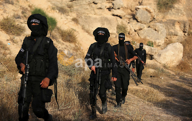 Palestinian militants guard the border in the east of Gaza city on the Muslim holy fasting month of Ramadan on May 24, 2018. Ramadan is sacred to Muslims because it is during that month that tradition says the Koran was revealed to the Prophet Mohammed. The fast is one of the five main religious obligations under Islam. More than 1.5 billion Muslims around the world will mark the month, during which believers abstain from eating, drinking, smoking and having sex from dawn until sunset. Photo by Ashraf Amra
