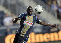 CHESTER, PA - AUGUST 12, 2012:  Bakary Soumare (4) of the Philadelphia Union pulls in a high ball against the Chicago Fire during an MLS match at PPL Park, in Chester, PA on August 12. Fire won 3-1.