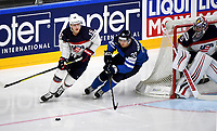 American Jack Eichel (L) skates with the puck under his possession past Finland's Markus Hannikainen during the Ice Hockey World Championship quarter-final match between the US and Finland in the Lanxess Arena in Cologne, Germany, 18 May 2017. Photo: Monika Skolimowska/dpa /MediaPunch ***FOR USA ONLY***