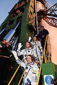 Baikonur Cosmodrome, Kazakhstan - September 18, 2006 -- Attired in their Russian Sokol launch and entry suits, prime crewmembers for the upcoming mission to the International Space Station (ISS) wave goodbye to the cameras at the launch pad. From bottom to top are cosmonaut Mikhail Tyurin, Expedition 14 Soyuz commander and flight engineer representing Russia's Federal Space Agency; astronaut Michael E. Lopez-Alegria, commander and National Aeronautics and Space Administration (NASA) space station science officer; and spaceflight participant Anousheh Ansari. The Soyuz TMA-9 spacecraft lifted off from the Baikonur Cosmodrome in Kazakhstan September 18, 2006 at 10:09 a.m. Baikonur time. .Credit: Bill Ingalls - NASA via CNP