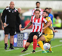 Lincoln City's Jordan Maguire-Drew under pressure from Morecambe's Aaron Wildig<br /> <br /> Photographer Chris Vaughan/CameraSport<br /> <br /> The EFL Sky Bet League Two - Lincoln City v Morecambe - Saturday August 12th 2017 - Sincil Bank - Lincoln<br /> <br /> World Copyright &copy; 2017 CameraSport. All rights reserved. 43 Linden Ave. Countesthorpe. Leicester. England. LE8 5PG - Tel: +44 (0) 116 277 4147 - admin@camerasport.com - www.camerasport.com